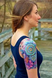 sun moon and tattoos on back