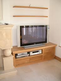 brown wooden cabinet and grey led tv on ceramics flooring plus