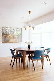 best 25 dining room decorating ideas only on pinterest dining minimalist mid century modern inspired dining room decor with blue chairs california living by carter design