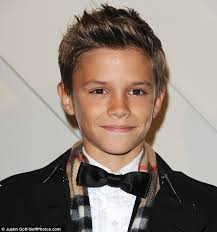 ten year ild biy hair styles romeo beckham steals the spotlight from parents david and victoria