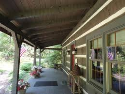 rustic porch with exterior stone floors u0026 wrap around porch in