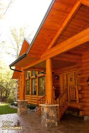 golden eagle log and timber homes log home cabin pictures covered porch cultured stone concrete piers exterior