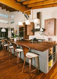 kitchen island with stools treglence wooden bar stools gray open shelveing island white wood plank backsplash pendant lights wall cabinets medium flooring kitchen counter