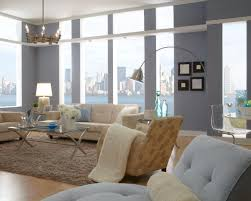 modern living room with floor to ceiling windows design and tufted