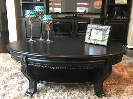 coffee table refinished in valspar black boots and distressed