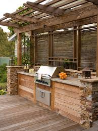 pergola over an outdoor kitchen bar for buffet style parties or