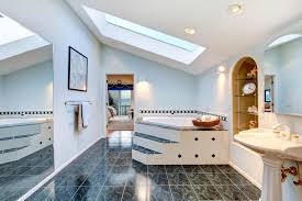 master bathroom with blue marble tile floor and corner bath tub