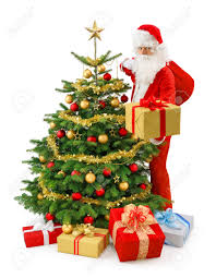 santa claus standing beside a gorgeous christmas tree and