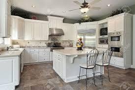 White Island Kitchen Kitchen In Luxury Home With Large White Island Stock Photo