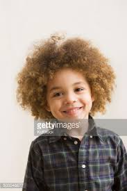 boys hairstyles mixed raced mixed race boy laughing stock photo getty images