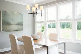 blue and gray dining room with stainless steel and maple dining