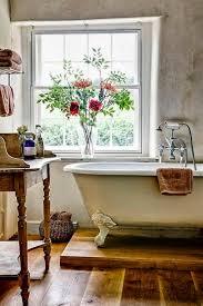 36 best farmhouse bathroom design and decor ideas for 2017 farmhouse bathroom decor with elevated bathtub