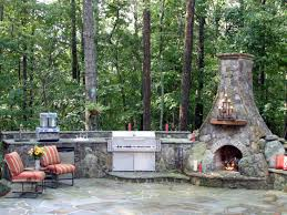 custom outdoor kitchen in the lush pine forest with a traditional