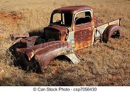 rusty pickup truck wreck of a rusty old pickup truck out in the field stock photography