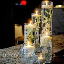 Floating Candle Centerpieces by Vases With Water And Float Bright Red Or Orange Flowers And Tea