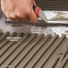 Can You Install Tile Over Laminate Flooring Tile Installation How To Tile Over Existing Tile Family Handyman