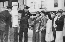 President Franklin Roosevelt signs Executive Order      on     HistoryLink org Seattle posting of Japanese Exclusion Order