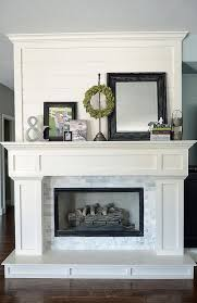 Mantel Fireplace Decorating Ideas - fireplace decorating idea with mirror 1 and organic green wreath