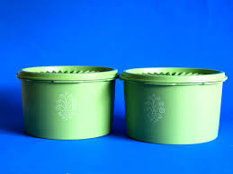 lime green kitchen canisters lime green tupperware containers with white stylised flower swirl