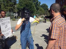 Black Guy With Confederate Flag Student Arrested After Wearing Gorilla Mask Handing Out Bananas