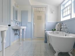 bathroom double sinks beadboard blue and white wall sconces