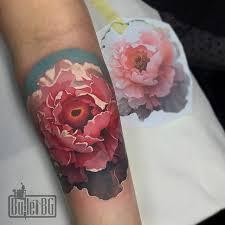 realistic peony flower tattoo on forearm