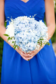 blue wedding bouquets the bridesmaids carried soft bouquets of light blue and white