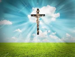 jesus christ on cross radiates light in sky over landscape u2014 stock
