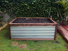 raised galvanized steel planter box that peter built easy to
