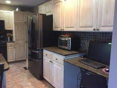 tropical brown granite countertops with white cabinet home