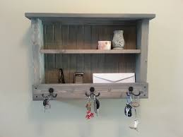 Grey Entryway Table by Black Entryway Wall Organizer On The Cream Wall With Wooden Table
