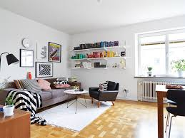 warm and inviting large scandinavian living room with a grey sofa