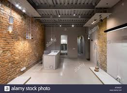 office in a loft style with brick and gray walls there are many
