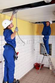 electrician wiring a building stock photo colourbox