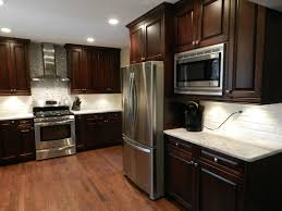 black kitchen cabinets with marble countertops wood cabinets and marble counter tops newline design