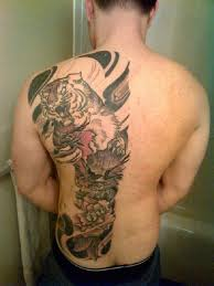 awesome half tiger back tattoo ideas for men back tattoo for
