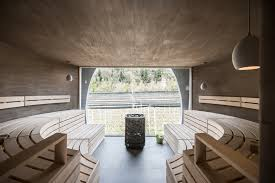 designboom italy applesauna by noa emerges from the valley landscape in italy