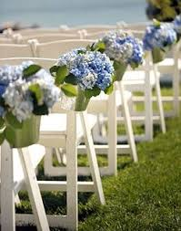 hydrangea wedding blue and purple hydrangea wedding aisle décor spotted on