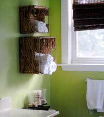pretty creative floating towel storage hang on green wall painted