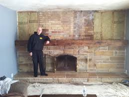 finished and installed mantel before stone work 14 foot mantel