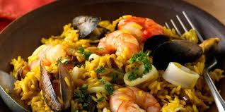 cuisiner une paella paella espagnole recette sur cuisine actuelle