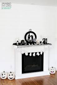 delightful black and white halloween mantel