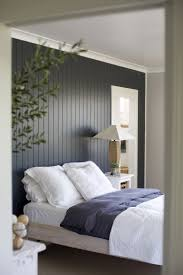 Black And White Bedroom With Color Accents Dark Painted Wood Paneling Accent Wall Bedrooms Pinterest