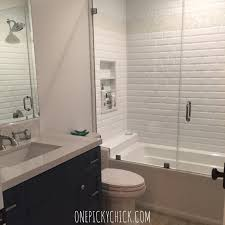 5 tips for a sophisticated coastal new home or total rebuild she wanted this bath to be fun i e the dark blue vanity without being over the top crazy her kids are close to being