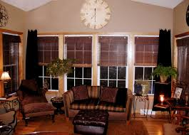 living room sunroom idea with bamboo window shades and stripped