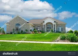 suburban home beautiful brick home suburbs stock photo 11553169