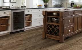 white kitchen cabinets with vinyl plank flooring luxury vinyl plank arrow carpet one floor home in andover