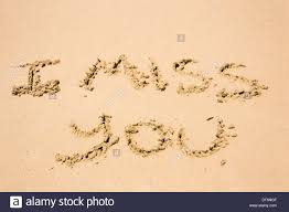 words i miss you hand written in the sand stock photo royalty