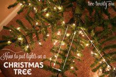 how to put lights on a christmas tree video designer secrets for how to decorate a christmas tree design