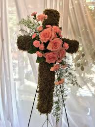 moss covered cross with roses and carnations in edison nj e e